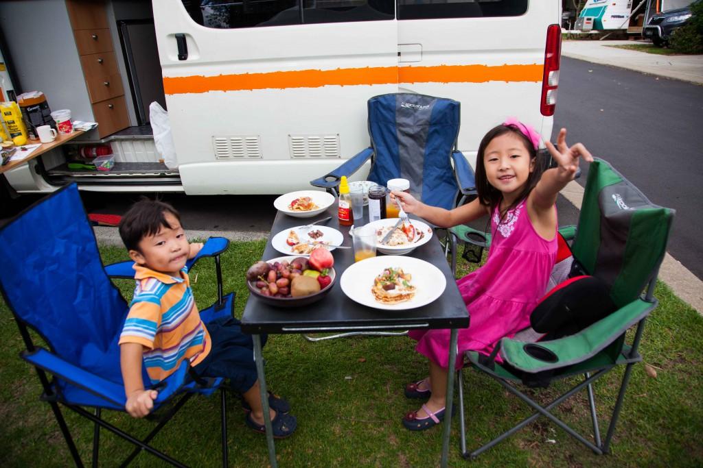 Kids enjoying pancakes for breakfast