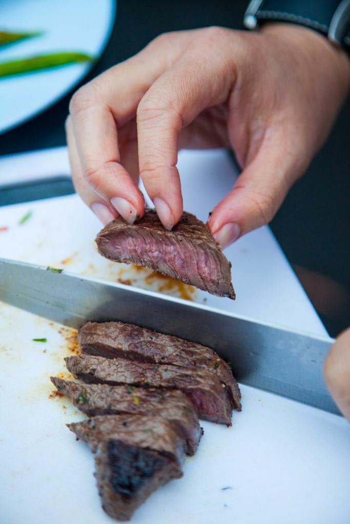 Slicing of beef steak, revealing a nice medium well centre.