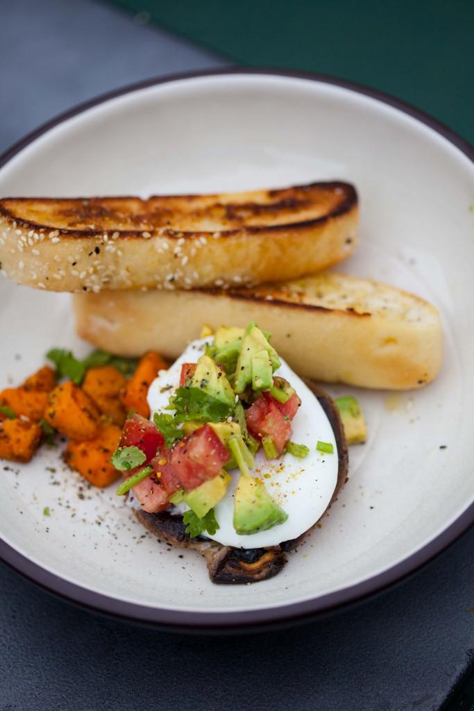 Poached egg on portobello with sweet potato hash and avo salsa, breakfast