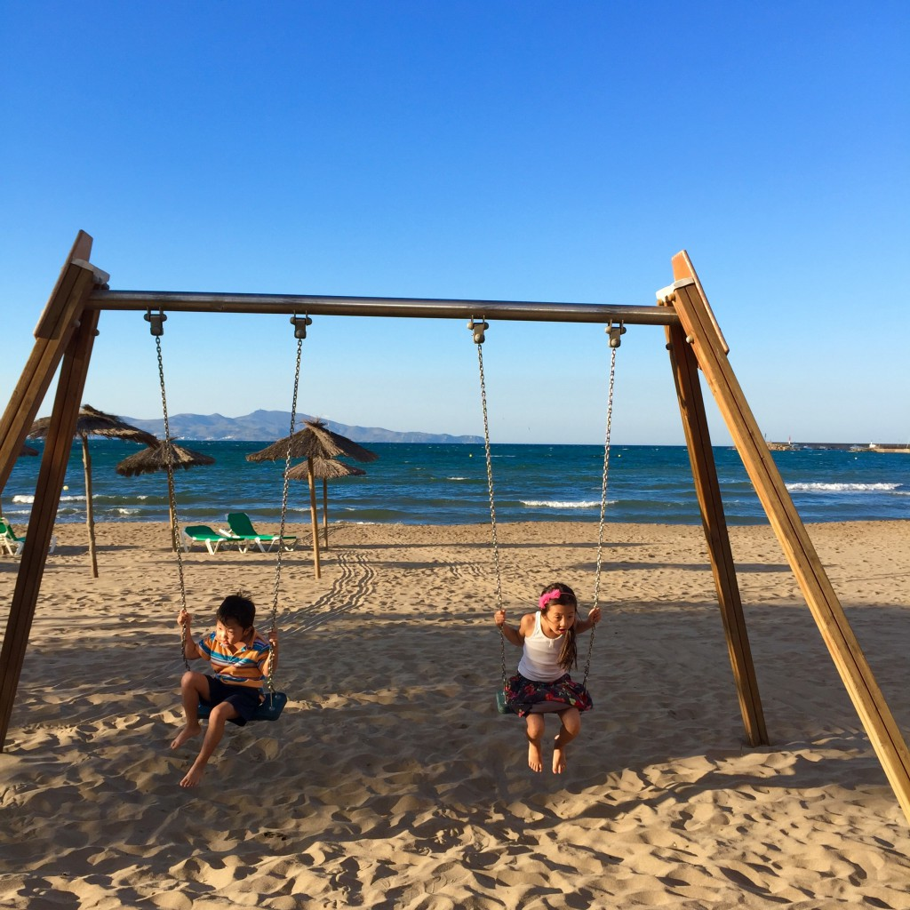 L'Escala kids on swing