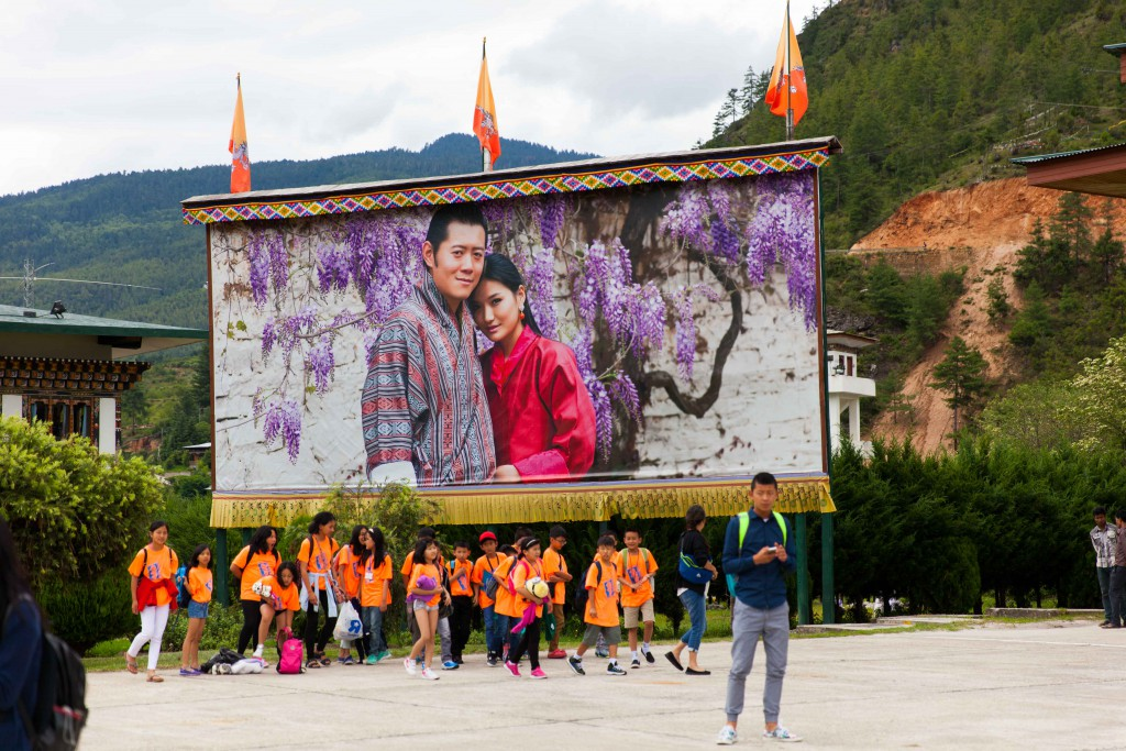 Everyone, and I mean everyone, poses before this huge poster of the much-loved King and Queen of Bhutan at the airport.