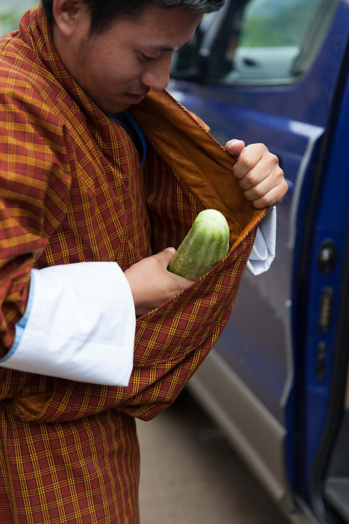 Ugyen demonstrating how the Bhutanese men keep their produce, without plastic bags!