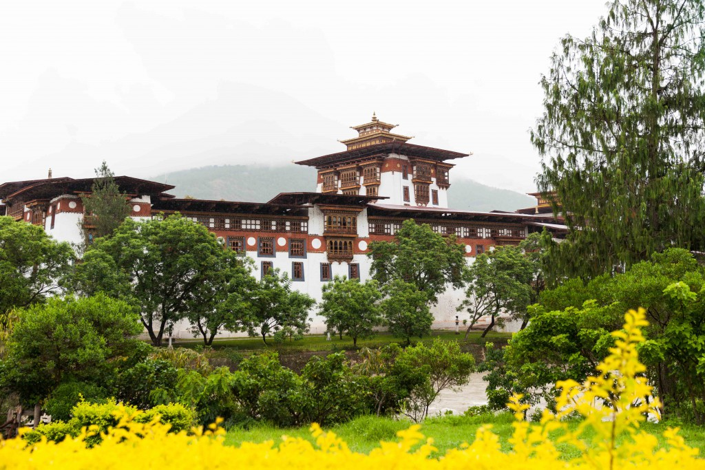The captivating Punakha Dzong flanked by two main rivers and garlanded by glorious summer blooms.
