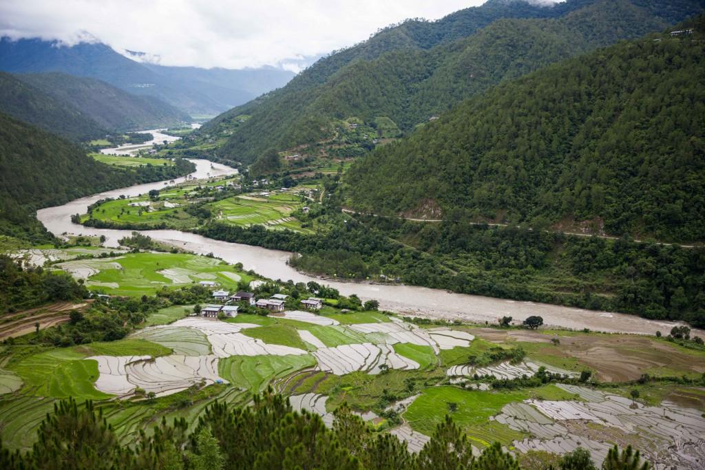 Rice paddies and valleys of green atop Khumsam Yulley Namgyal Chorten.
