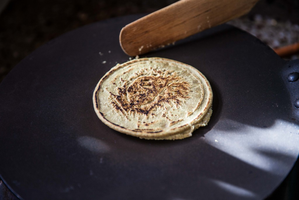 The buckwheat pancakes ala Bhutan style on their dosai pan.