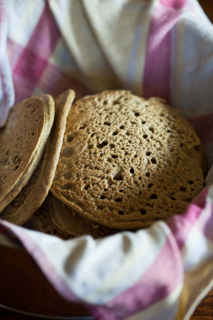 The buckwheat pancakes kept in a tea towel in a pot to keep them warm.