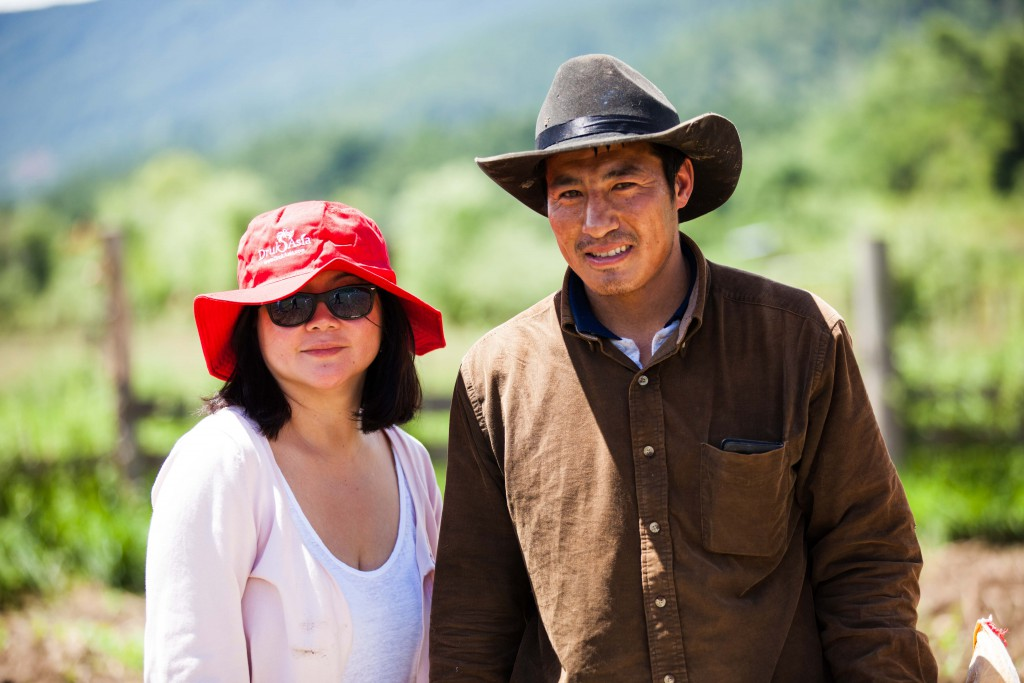 All hatted out at the potato field with the young owner.