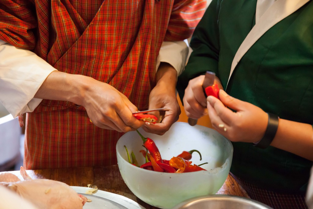 The hands at work to bring food to the table.