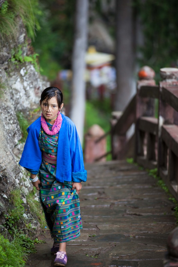 A Bhutanese in her kira making the last few steps towards Tiger's Nest.