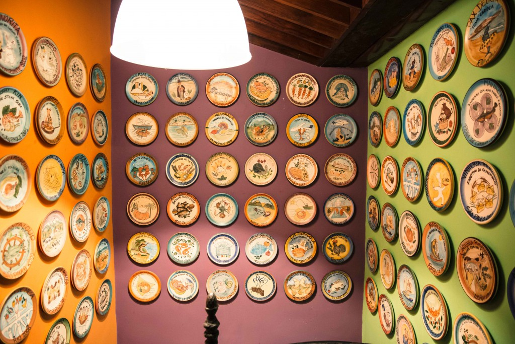 A wall decorated with special edition handcrafted plates collected over the years