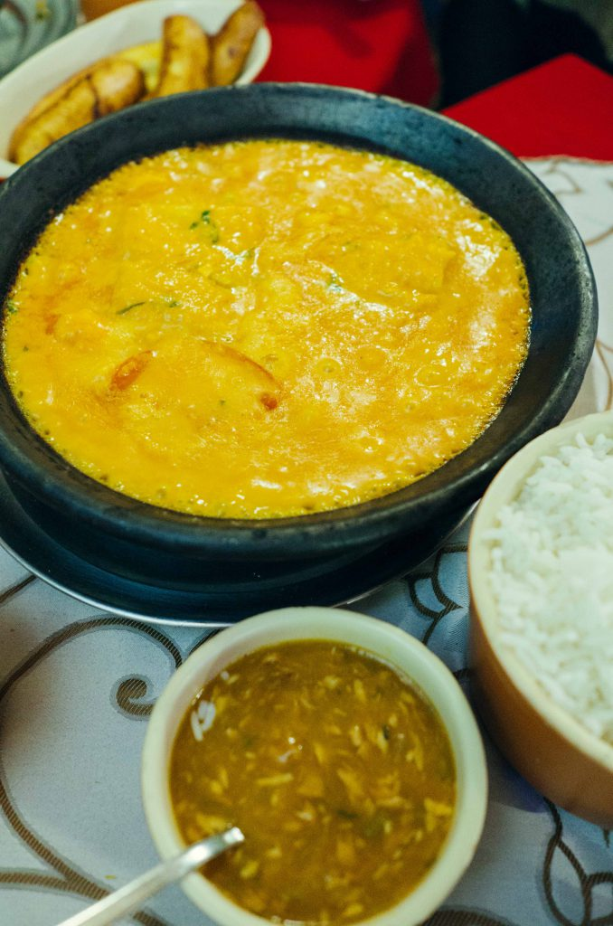 Traditional Moqueca Mista, Baiana style using coconut milk and dende oil. This is a much richer version and reminds me very much of Indonesian food. Seen here served with pirao, a kind of fish stew mush thickened with manioc flour.