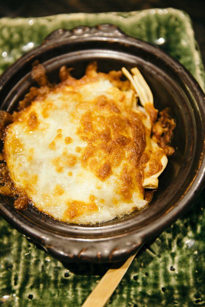 Crab miso cheese with pasta at Izakaya Itaru Honten in Kanazawa.