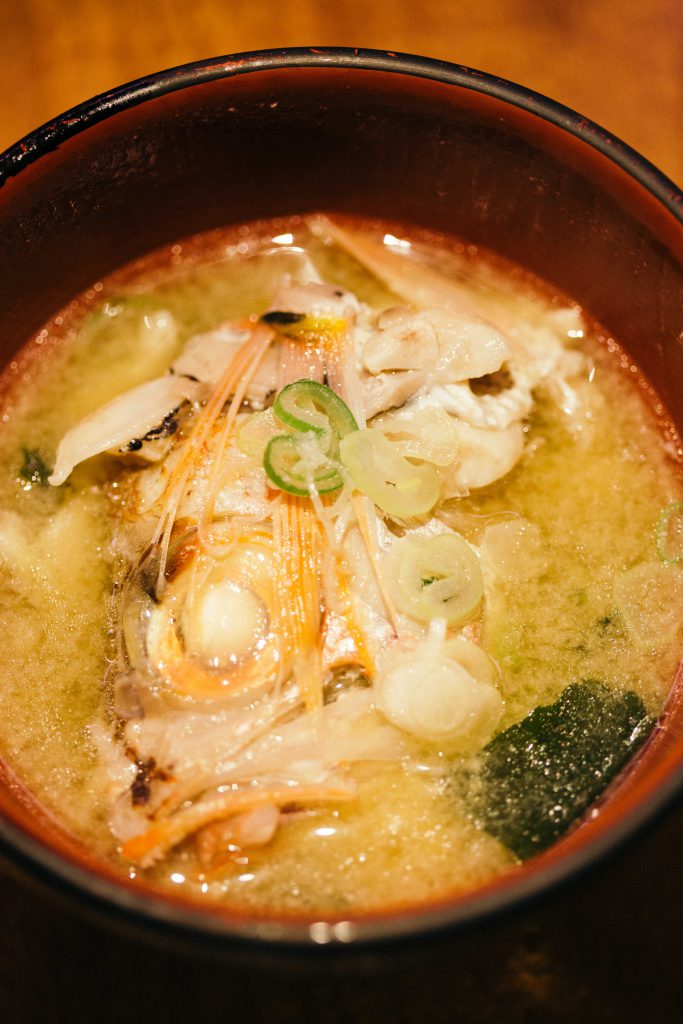 Arajiru, a miso soup made with fish head and bones typical fare in a sashimi restaurant. Nothing goes to waste in Japan, after the fillets are used to make sashimi and sushi, the bones are used to make flavourful miso soup.